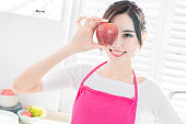 Asian housewife hold an apple