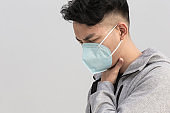 man sore throat with mask