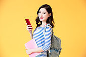 asian student use smart phone