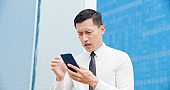 man worry while looking smartphone