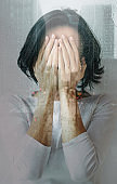 Depressive episode. Close-up photo of a stressed girl, who is crying and covering her face while feeling sorrowful and lonely. Double exposure.