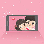 Couple are taking selfies camera mobile phone.