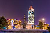 Italian style clock tower at night
