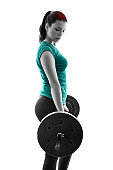 Fit young woman exercising with a barbell