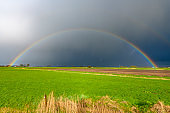 Rainbow during a rain and hail storm over the delta of the river IJssel