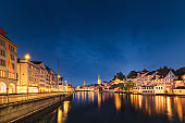 Cityscape of Zurich City and Illuminated Lights at Nightlife, Landscape Historic Old Town of Zurich, Switzerland. Panoramic View Medieval Architecture of Switzerland at Night. Travel Place Landmark