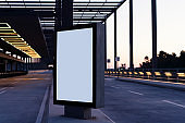 Blank Billboard in the airport with no people at dusk