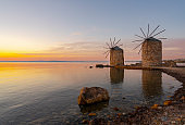 Old traditional windmills on beach of Chios, Greece