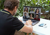 Businessman in his home office making a video conference call meeting with friends