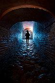 Man walking towards to exit through the dark corridor  in Hagia Sophia, Istanbul, Turkey