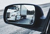 Semi Truck in Side Mirror