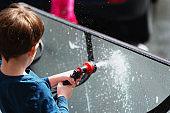 Boy Washing Patio Table