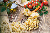 Pasta collection on rustic wooden. top view Various types of Italian raw food