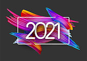 2021 sign on colorful brush strokes background.