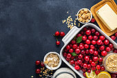 Ingredients for cooking pie with cherries on dark background copy space top view