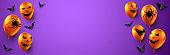 Orange 3d balloons on violet background.