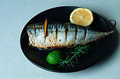 Makrel with lemon, rosemary and spice, baked in the oven. Marinade for fish. The concept of proper nutrition. Healthy food