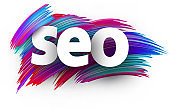 Seo sign letters on brush strokes background.