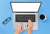 Woman use laptop typing on the keyboard Internet Marketing concept top view