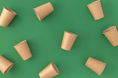 Disposable paper cups on green background Zero waste plastic free concept