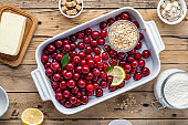 Top view raw ingredients for cooking cherry pie wooden table