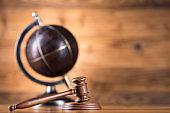 Globe, Law theme, mallet of judge, wooden gavel