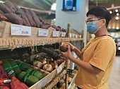 An asian chinese female wearing a mask going out shopping in supermarket buying