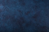Dark navy blue stone texture background. Top view. Copy space.