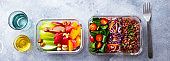 Lunch box with vegetables, brown rice and fruits salad. Healthy eating. Grey background. Top view.