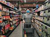 An asian chinese female wearing a mask going out shopping in supermarket buying grocery