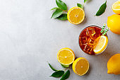 Ice tea with fresh lemons. Grey background. Copy space. Top view.