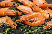Shrimp and rosemary branch close up