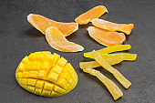 Mango fruit and candied mango. Bright color snack. Natural source of energy.