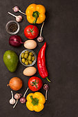 set of vegetables for a healthy diet, yellow and red peppers, tomatoes, onions,