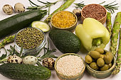 Healthy food for diet and lifestyle: green vegetables, quinoa bulgur, chickpeas, flax almond.