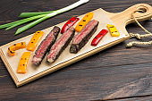 Fresh grilled meat. Grilled marbled beef steak medium rare with vegetables on wooden cutting board