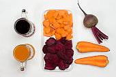 Sliced beets and carrots in white plate. Root vegetable of beets and carrots.