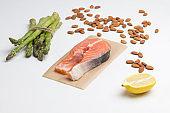Fish steak,  fresh raw salmon.  asparagus lemon almonds. Redfish source omega-3.