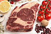 Marbled beef steak with vegetables, beans, nuts