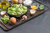 Mix broccoli and Brussels sprouts in pan