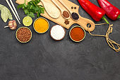 Different types of rice and spices. Wooden cutting board