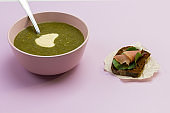 Vegetable broccoli puree soup in pink bowl
