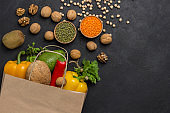 Set of balanced products for healthy diet. Paper bag with vegetables