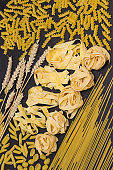 Spikelets of wheat and raw pasta. Dietary fiber Carbohydrates