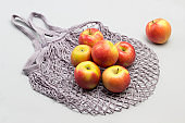 Cotton String Mesh Bag and red apples.