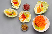 Vegan cabbage leaf snack with carrots.