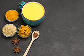 Herbal therapy concept.  Golden latte with ingredients for cooking