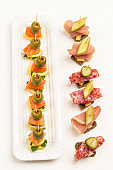 Assortment of canapes with salmon, bacon, cheese, pickles
