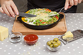 Stewed eggs and vegetables in a pan