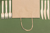 Paper bag and wooden forks and knives.